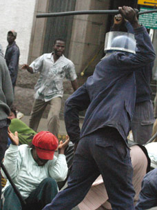 Zimbabwean police assault members of the National Constitutional Assembly who were demonstrating for a new Constitution in Harare, Wednesday, July, 25, 2007.