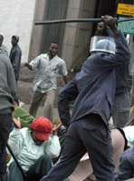 Zimbabwean police assault members of the National Assembly, July 2007
